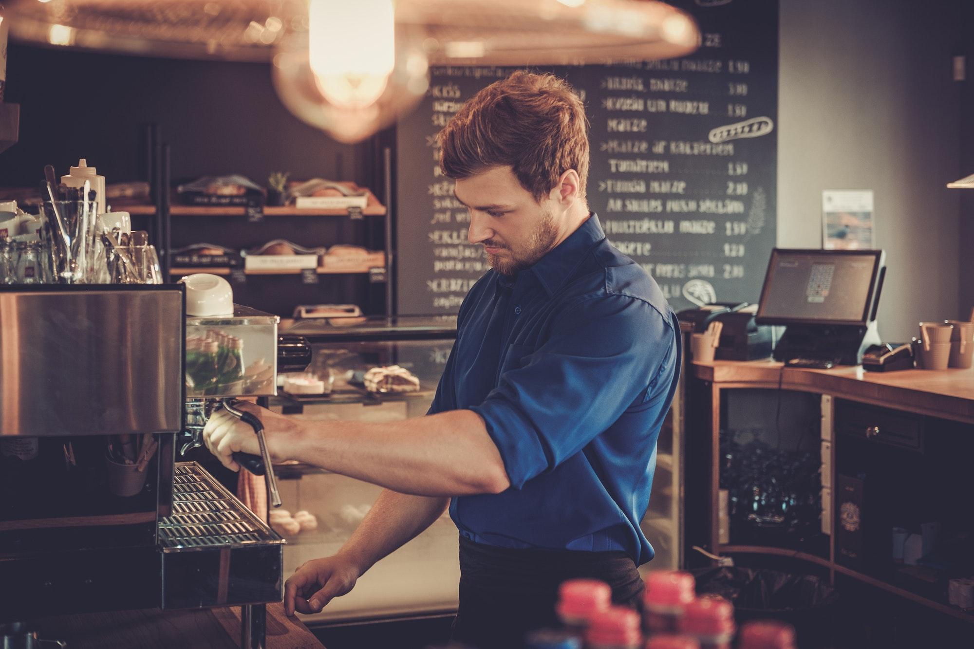 barista-preparing-cup-of-coffee-for-customer-in-coffee-shop-.jpg